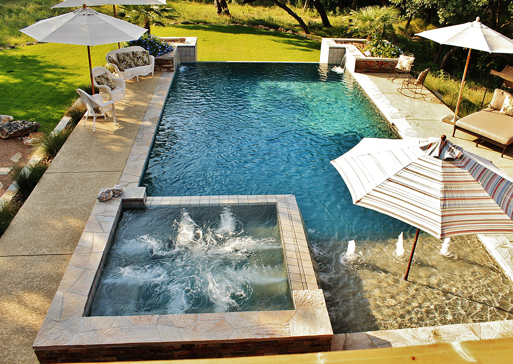 New swimming pool and spa combination gallery trinity for Spa construction